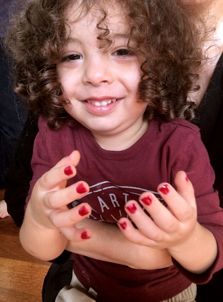kid licks edible nail polish